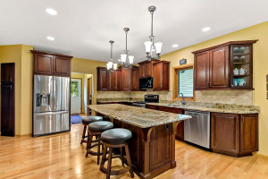 The cooks in the family will love sharing their craft in this updated kitchen with cherry cabinetry, granite countertops, hardwood floors and stainless steel appliances.