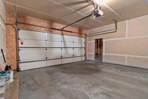 Garage stalls one and two are 20.6 x 23, and have a door leading to the oversized third stall.