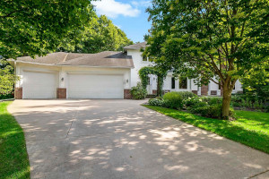 The home is at the end of a cul-de-sac with three-car garage and concrete drive.