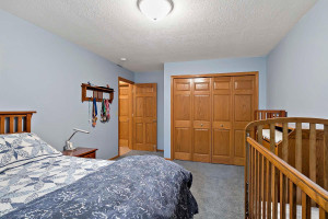 The sixth bedroom in the home is in the lower level. Plenty of space for the extended family.