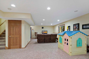 The lower level has over 1,100 square feet, a bedroom and bath; perfect for a live-in relative.