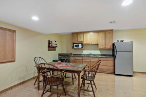 Lower level Includes a wet bar, a place to hold game night, television watching, plus bedroom six and a three-quarter bath.