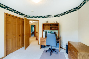 Bedroom 5 on the upper level is currently used as a second home office.