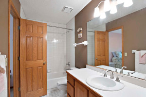 Third full bath on the upper level is an ensuite to one of the bedrooms.