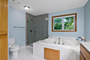 Owner's suite bath has a recently upgraded shower and countertops.