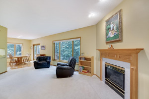 The main level family room has a warm and cozy gas-burning fireplace.
