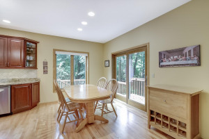 Eat-in kitchen area, with access to the main level family room. Open-concept space keeps friends and family together during the big game, or for special occasions.