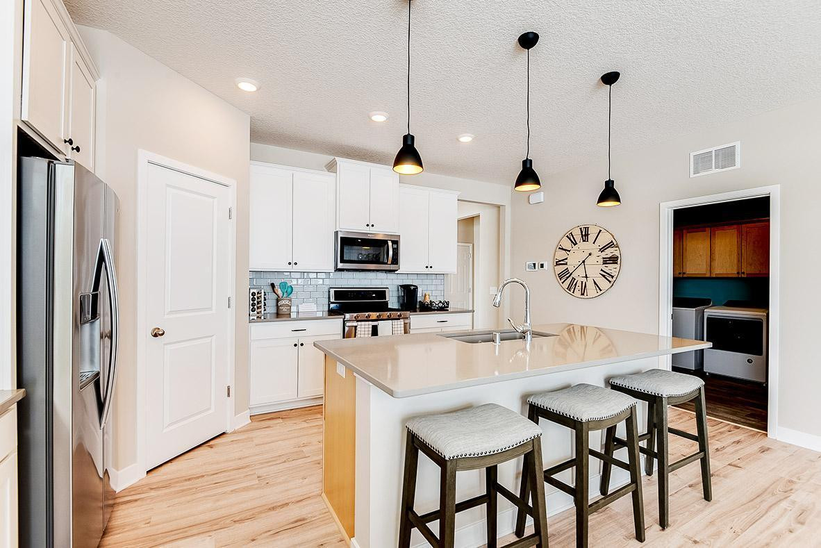 Open Concept Design - Informal Dinning. Photos are of model, colors may vary.
