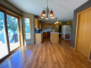 Dining Space walks out to Back Deck with great natural daylight from Sliding Door and Windows