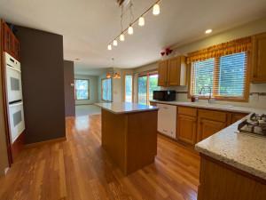 Kitchen w/ Center Island and Hardwood Floors