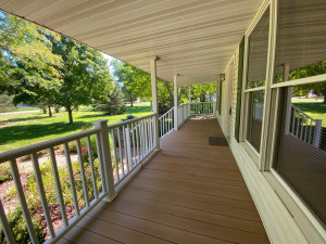 Wonderful front porch across entire front of Home