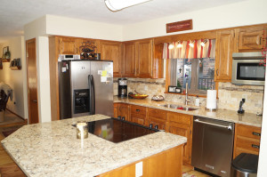 Kitchen has stainless steel appliances and center island