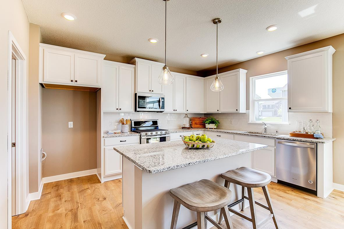 Bright and beautiful, to words to describe the kitchen in the Bridgewater. *photos are of model home, finishes in actual home may vary.