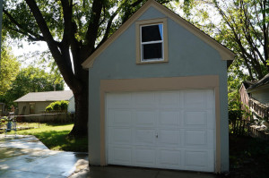 Garage with new door and new concrete work