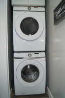 Main floor laundry off kitchen with new washer and dryer