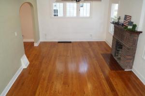 Living room has hardwood floors and fireplace
