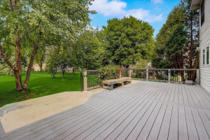 Enjoy the outdoors in the lush flat backyard with expansive maintenance free deck and gorgeous greenery.