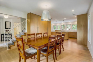 Generously sized formal dining with plentiful of space for a massive dining table + convenient built-in hidden storage.