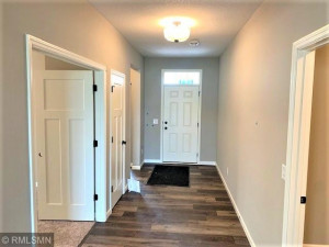 Spacious Foyer off front 2 bedrooms and mud room.
