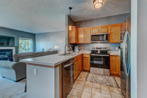 Kitchen features brand new stainsless steel appliances.
