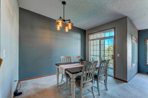 The dining room has easy access to the deck for grilling.