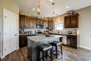 Granite countertops, cool lighting, cabinets galore.