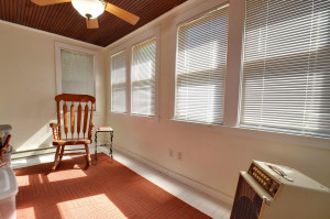 4 Season sun porch (through bathroom). Great flex room.