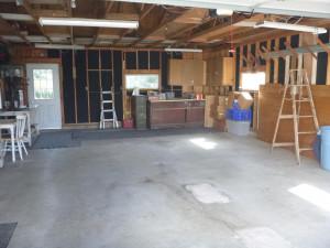 Garage interior with access door to backyard