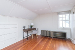 Bedroom, office, craft room, den - this third level space is versatile with closets and built-ins.