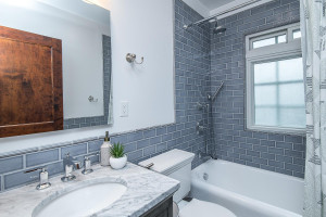 Upper level full bath with classy subway tile surround.
