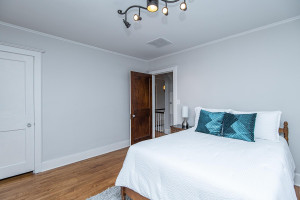 Another second level bedroom with hardwood flooring.