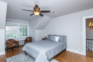 Another spacious bedroom with hardwood flooring.