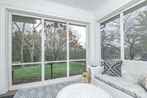 Enjoy your summers in this enclosed screened porch.