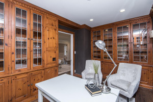 Built-in wood cabinetry and wood flooring in this main floor den.