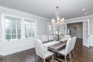 Elegant formal dining with crown molding and hardwood floors.