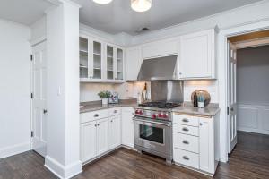 Kitchen offers hardwood flooring quartz counter tops!