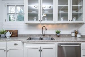 Elegant back splash tile with under cabinet lighting.