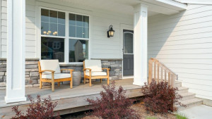 The simple pleasures of life! Enjoy an evening sunset on this covered porch that comfortably fits a few chairs and small table for relaxing and enjoying the seasonal weather. *pictures are of model home, actual colors may vary.
