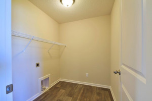 Centrally located on the upper level, along with the four bedrooms, this laundry room is sure to provide the ultimate convenience. *pictures are of model home, actual colors may vary.