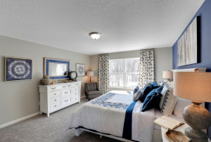 Enjoy this luxury private bedroom with an abundance of natural light and room for a pleasant reading space. *pictures are of model home, actual colors may vary.