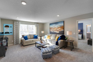 Large enough to fit the sofa, a couple chairs, a TV stand and even a desk, this second level game is situated perfectly in this layout and is just steps from each of the four upper level bedrooms. *pictures are of model home, actual colors may vary.