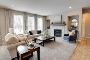 Large family room windows facilitate the abundance of main floor natural light. *pictures are of model home, actual colors may vary.