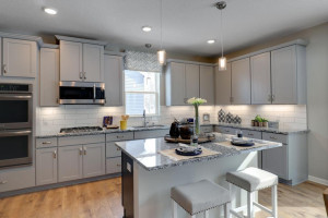 This kitchen features granite kitchen countertops, a walk-in pantry, signature kitchen with double ovens and a gas cooktop, stainless appliances and more! *pictures are of model home, actual colors may vary.