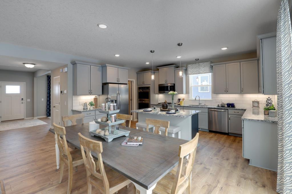 The open layout provides an optimal area to cook and entertain. Envision gathering together in the heart of this home. *pictures are of model home, actual colors may vary.