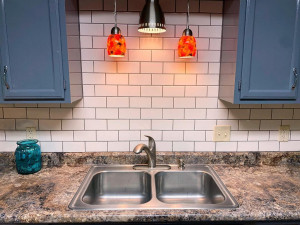 ...Bright Subway Tile and Accent Lighting...