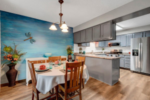 The Adjacent Upper Kitchen Cabinets Open to Both the Kitchen and Dining Area for Convenience.