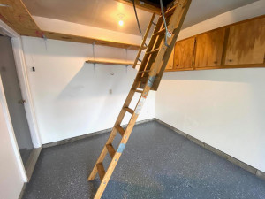 ...Cabinet and Shelf Storage and Ladder Access to Additional Lighted Storage Up Above.