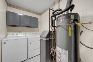 The Spacious Laundry and Utility Area has an Overhead Solar Tube for Natural Light. Updates Here Include: Rheem Water Heater and Water Softener (2021) and Lennox Furnace (New 2018)...