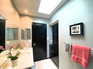 You'll Notice Right Away the Abundant Natural Lighting from a Skylight and Enameled Vanity and Linen Cabinets.