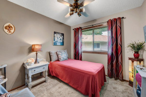 Bedroom 2 has East Views and also has a Ceiling Fan and New Carpeting.